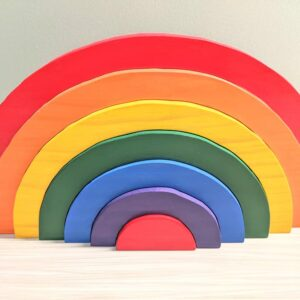 Painted wooden rainbow stacker puzzle toy in traditional rainbow colors