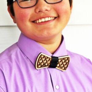 closeup of teen wearing wooden two toned bow tie calluna