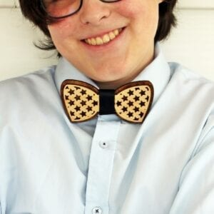 crop teen wearing wooden bow tie with stars